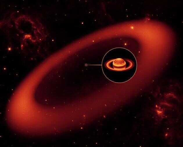 斯皮策太空望远镜发现的土星周围巨大而微弱的光环(想象图)