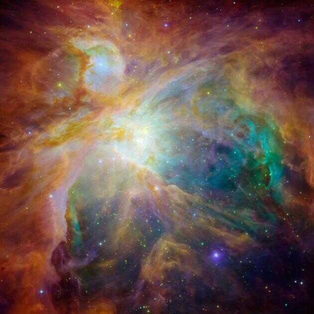 利用斯皮策太空望远镜的数据,天文学家合成了这张猎户座星云中年轻恒星的图像